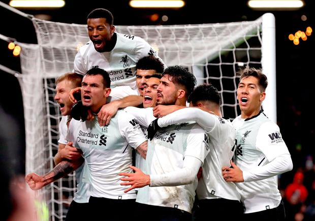 Liverpool's Dejan Lovren (second left) and Liverpool's Emre Can celebrates with team-mates after Liverpool's Ragnar Klavan (left) scores his side's second goal of the game during the Premier League match at Turf Moor, Burnley. Martin Rickett/PA Wire