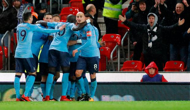 Soccer Football - Premier League - Stoke City vs Newcastle United - bet365 Stadium, Stoke-on-Trent, Britain - January 1, 2018 Newcastle United's Ayoze Perez celebrates scoring their first goal with team mates Action Images via Reuters/Carl Recine