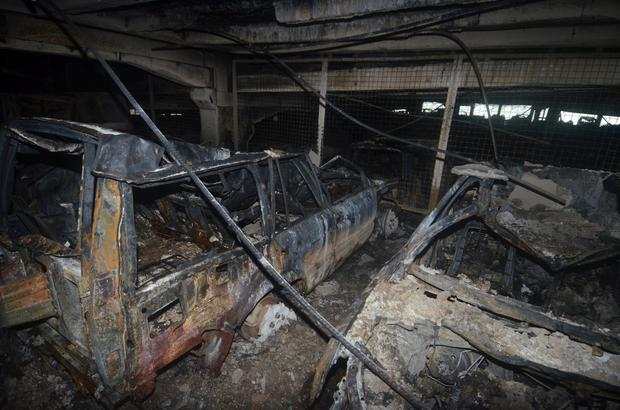 Burnt cars are seen in what remains of the multi-storey car park, where a large fire destroyed many cars on Sunday