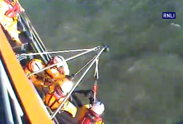 The stranded surfer was pulled from the water by the RNLI