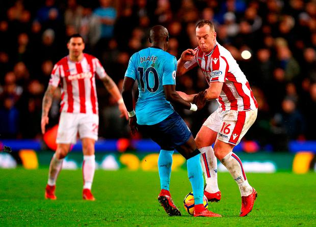Stoke City's Charlie Adam (right) and Newcastle United's Mohamed Diame (left) battle for the ball. Photo credit: Dave Thompson/PA Wire.