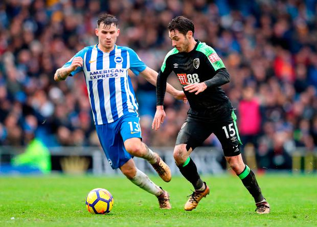 Brighton & Hove Albion's Pascal Gross (left) and AFC Bournemouth's Adam Smith battle for the ball. Photo credit: Adam Davy/PA Wire.