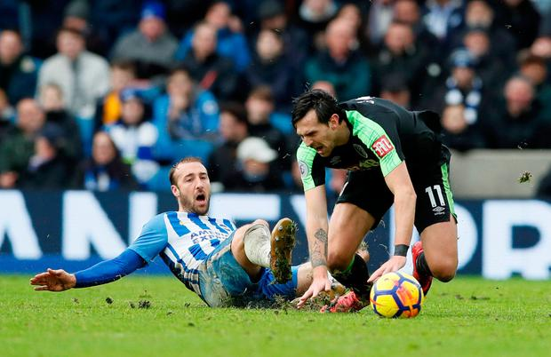 Brighton's Glenn Murray in action with Bournemouth's Charlie Daniels. Photo: Reuters/David Klein