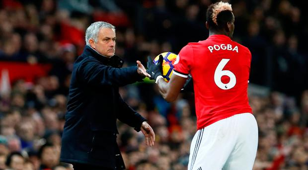 Soccer Football - Premier League - Manchester United vs Southampton - Old Trafford, Manchester, Britain - December 30, 2017 Manchester United manager Jose Mourinho and Paul Pogba. Action Images via Reuters/Jason Cairnduff