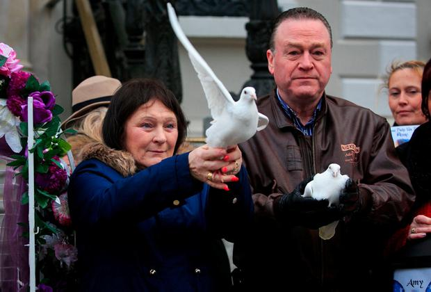 Christine Kenny during a vigil for Amy Fitzpatrick at the Mansion House in Dublin, at which a number of doves were released in her memory. Photo: Gareth Chaney