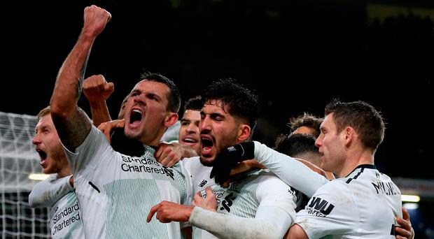 Dejan Lovren and Emre Can lead the celebrations. Photo by Nigel Roddis/Getty Images