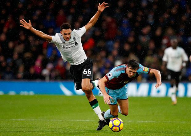 Burnley's Jack Cork in action with Liverpool's Trent Alexander-Arnold. Photo: Reuters/Phil Noble