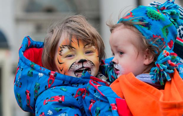 Noah (3, left) and Jonah Lynch (19 months) from Malahide at the New Year's Day Celebration at Custom House Quay. Photo: Gareth Chaney, Collins