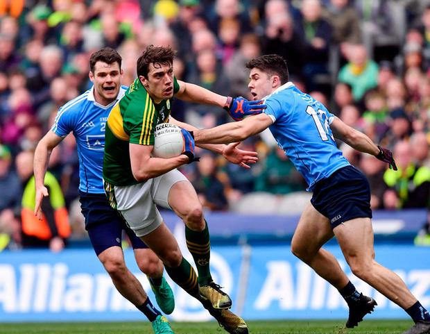 Kerry's David Moran is tackled by David Byrne of Dublin during last year's Division 1 league final. This year's decider will be played a week earlier. Photo: Ramsey Cardy/Sportsfile