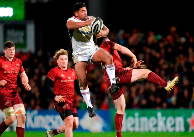 Ulster's Charles Piutau beats Munster's JJ Hanrahan in the air during the Guinness PRO14 clash in Belfast. Photo: Oliver McVeigh/Sportsfile