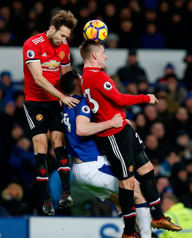 Manchester United's Daley Blind and Luke Shaw in action with Everton's Michael Keane. Photo: Reuters/Andrew Yates