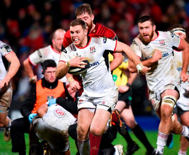 Ulster's Darren Cave on his way to scoring his side's first try. Photo: David Fitzgerald/Sportsfile