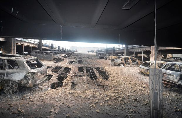 Burnt cars in what remains of the multistorey car park, where a large fire destroyed many cars in Liverpool. Photo: Merseyside Fire & Rescue Service/Handout via Reuters