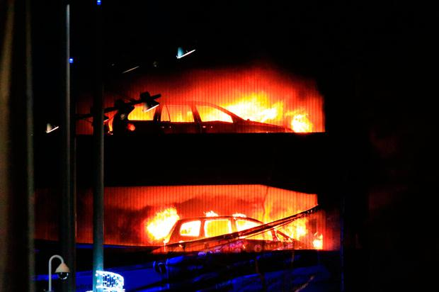 Vehicles burn during the blaze at the car park at the Echo Arena. Photo credit: Peter Byrne/PA Wire