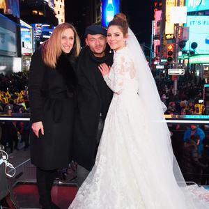 NEW YORK, NY - DECEMBER 31: Maria Menounos (R) holds her wedding ceremony with guests during Maria Menounos and Steve Harvey Live from Times Square at Marriott Marquis Times Square on December 31, 2017 in New York City. (Photo by Dimitrios Kambouris/Getty Images for MM)