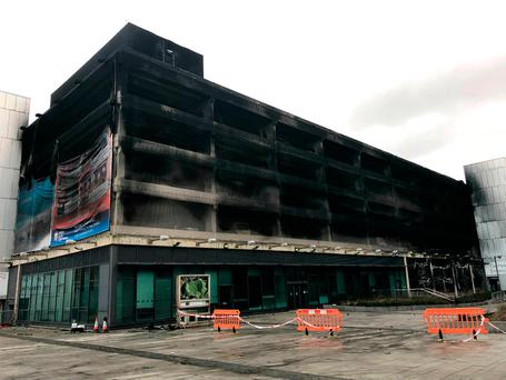 The burnt-out shell of the car park, with more than 1,000 vehicles inside. Photo: Merseyside Fire and Rescue Service/PA