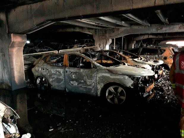 Some of the burnt out cars in the multi-storey car park near to the Echo Arena on Liverpool's waterfront. Photo: Merseyside Fire and Rescue Service/PA