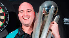World Champion Rob Cross. Photo: Steve Welsh/PA
