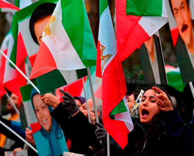 Protesters wave flags as they gather outside the Iranian Embassy in central London. Photo: Getty Images