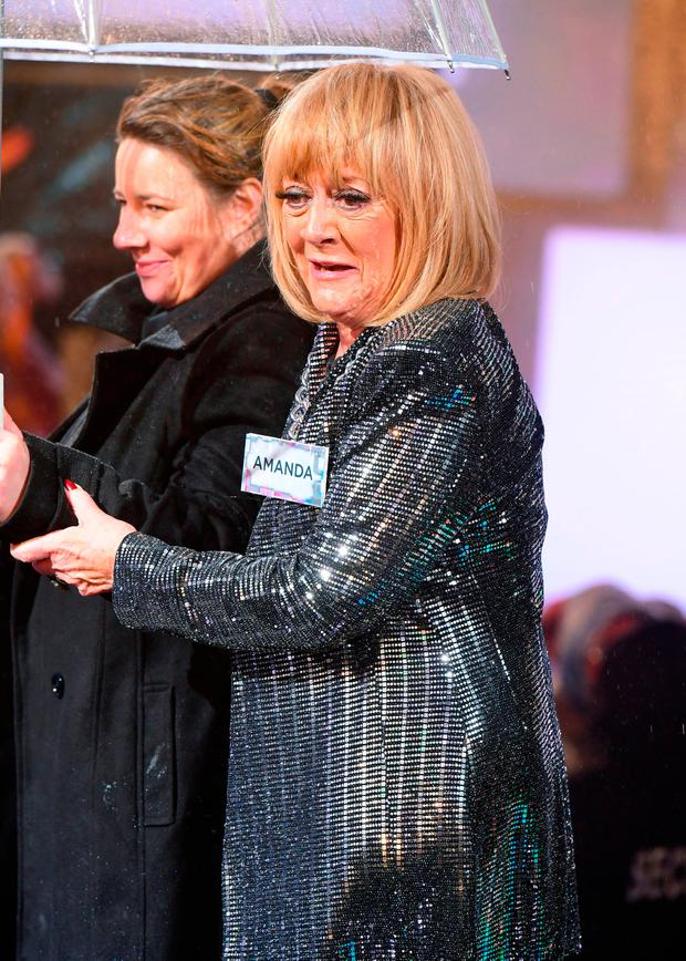 Amanda Barrie enters the house during the Celebrity Big Brother Launch held at Elstree Studios in Borehamwood, Hertfordshire. PRESS ASSOCIATION Photo. Picture date: Tuesday January 2, 2018. See PA Story SHOWBIZ CBB. Photo credit should read: Ian West/PA Wire