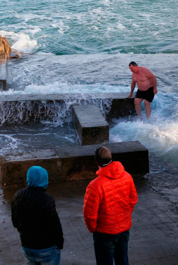 A hardy swimmer takes a dip at the Forty Foot in Dublin.Photo: Stephen Collins/Collins Photos