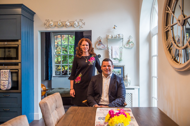 Mike Ross and his wife Kimberlee in their extended Gate Lodge home.
