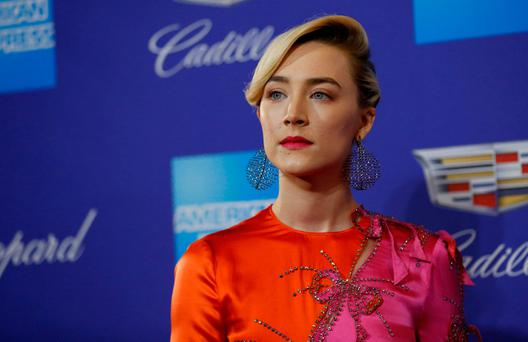 Actor Saoirse Ronan poses at the 29th Annual Palm Springs International Film Festival Awards Gala in Palm Springs, California, U.S., January 2, 2018. REUTERS/Mario Anzuoni