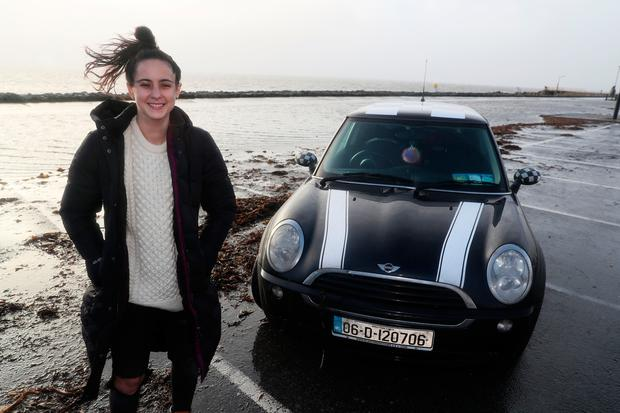 Selina Callaghan, from Kerrykeel, Donegal, at the car park on Salthill Promenade in Galway which she was parked in when storm Eleanor hit, leaving her to drive to safety through waves crashing onto the road. Photo Brian Lawless/PA Wire