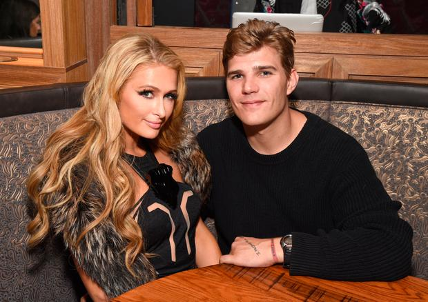 Paris Hilton (L) and Chris Zylka attend day three of TAO, Beauty & Essex, Avenue and Luchini LA Grand Opening on March 18, 2017 in Los Angeles, California. (Photo by Michael Kovac/Getty Images for TAO)