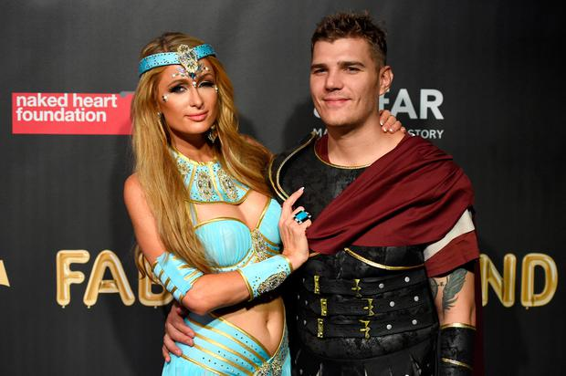 Paris Hilton and Chris Zylka attend the 2017 amfAR & The Naked Heart Foundation Fabulous Fund Fair at Skylight Clarkson Sq on October 28, 2017 in New York City. (Photo by Nicholas Hunt/Getty Images)