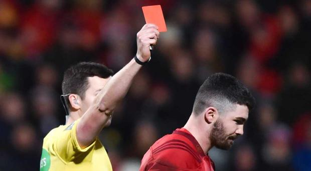 Sam Arnold of Munster is shown a red card
