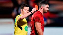 Referee Sean Gallagher shows Sam Arnold a red card during Monday's defeat to Ulster to increase Munster's card count for the season. Photo: David Fitzgerald/Sportsfile