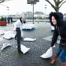 Locals prepare more sandbags in the aftermath of Storm Eleanor in Galway. Photo: Andrew Downes