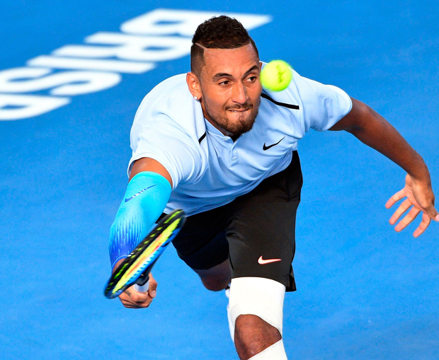 Australian Nick Kyrgios reaches for a return against compatriot Matthew Ebden during their singles match at the Brisbane International yesterday. Photo: Saeed Khan/AFP