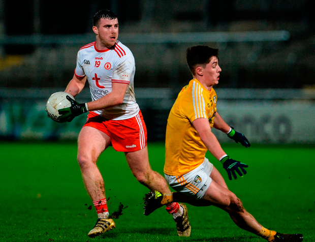 Connor McAliskey of Tyrone in action against Paddy McAleer of Antrim. Photo: Oliver McVeigh/Sportsfile