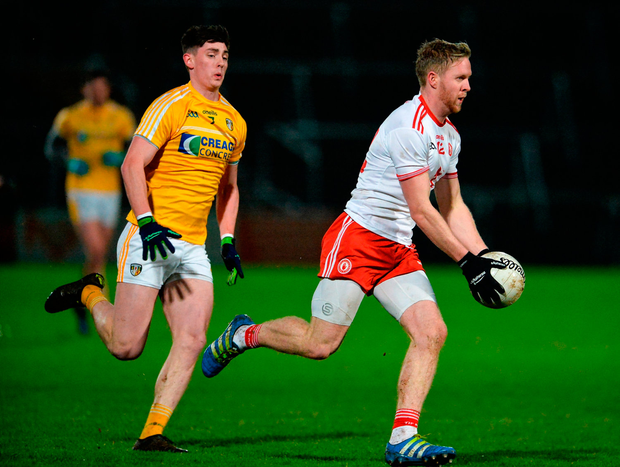 Frank Burns of Tyrone in action against Paddy McAleer of Antrim. Photo: Oliver McVeigh/Sportsfile