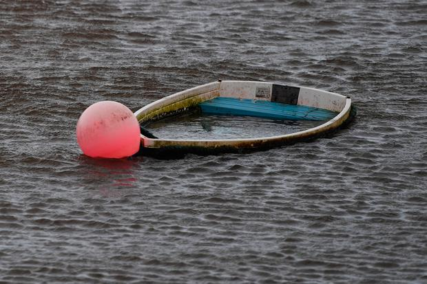 A sunken boat is seen half submerged after Storm Eleanor in Galway Bay. Photo: REUTERS/Clodagh Kilcoyne