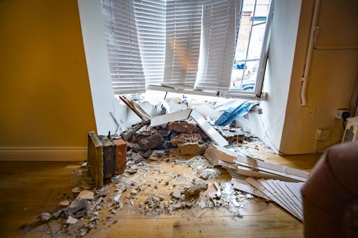 The scene in Cavendish Street , west Belfast where a car has crashed through the front window of a property on January 3rd 2018 (Photo by Kevin Scott / Belfast Telegraph)