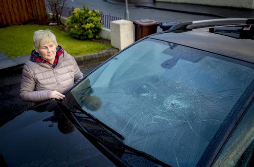 Lorraine McBride with her car in Newtownabbey on January 3 2018 (Photo by Kevin Scott / Belfast Telegraph)