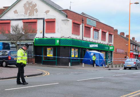 Police at the scene of a branch of Paddy Power in Rookery Road, Handsworth, Birmingham, after a man was arrested following a fatal stabbing at the betting shop Photo: Matthew Cooper/PA Wire