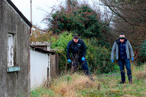 Garda searching a vacant property on Avenue Road in Dundalk, Co Louth