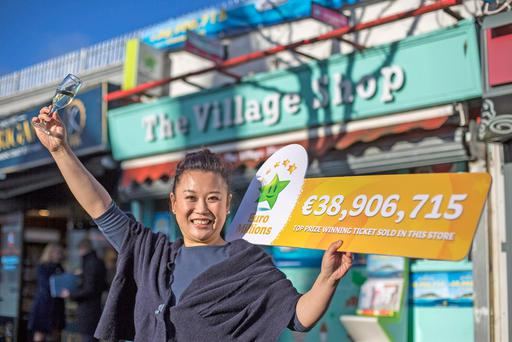 Amy Cong salutes the anonymous EuroMillions winner who bought their ticket at her shop – she's hoping they'll carry on shopping there. Photo: Mark Condren