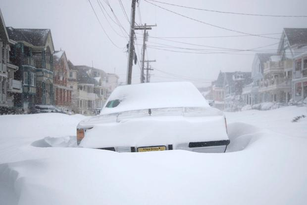 A vehicle parked on Abbott Avenue is surrounded by snowdrifts during a snowstorm that hit the New Jersey Shore, Thursday, Jan. 4, 2018, in Ocean Grove, N.J. A massive winter storm swept from the Carolinas to Maine on Thursday, dumping snow along the coast and bringing strong winds that will usher in possible record-breaking cold. (AP Photo/Julio Cortez)
