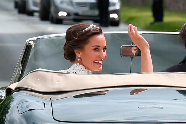 Bride Pippa Middleton and her new husband James Matthews (not seen) leave St Mark's Church in a classic car after their Wedding Ceremony on May 20, 2017 in Englefield, England. (Photo by Neil Mockford/GC Images)