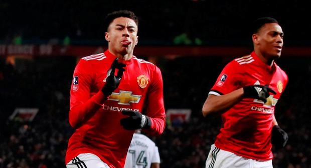 Manchester United's Jesse Lingard celebrates scoring their first goal with Anthony Martial. Action Images via Reuters/Jason Cairnduff