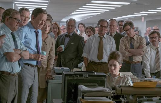 Tension: Hanks and Streep (third and fourth left) in The Post