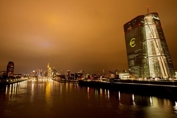 The European Central Bank's headquarters in Frankfurt is illuminated in the night sky. The European economy is growing strongly but inflation remains low. Photo: Bloomberg