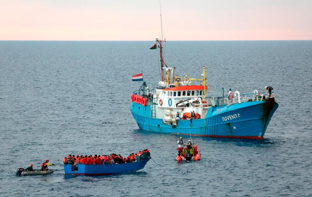 Migrants on a wooden boat are rescued off the Libyan coast. Photo: Reuters