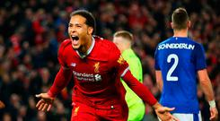 Virgil van Dijk of Liverpool scores the winner in the last round