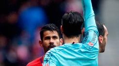 Atletico Madrid's Spanish forward Diego Costa receives a red card after celebrating a goal with supporters during the Spanish league football match Club Atletico de Madrid vs Getafe CF at the Wanda Metropolitano stadium in Madrid on January 6, 2018. / AFP PHOTO / OSCAR DEL POZOOSCAR DEL POZO/AFP/Getty Images
